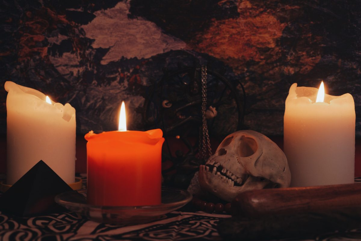 altar with skull statue and candles PHVSV6E 1200x800 - Ancestral Magic & Working With Your Ancestors