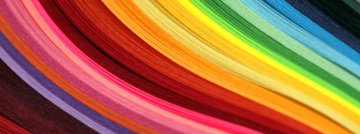 Horizontal Abstract vibrant color wave rainbow strip paper background.